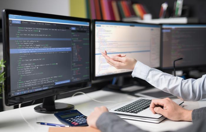 monitors displaying coding